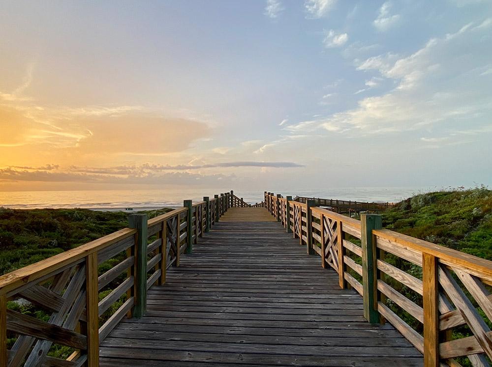Lively Beach boardwalk at sunrise