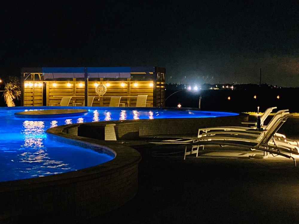 Lively Beach pool at night