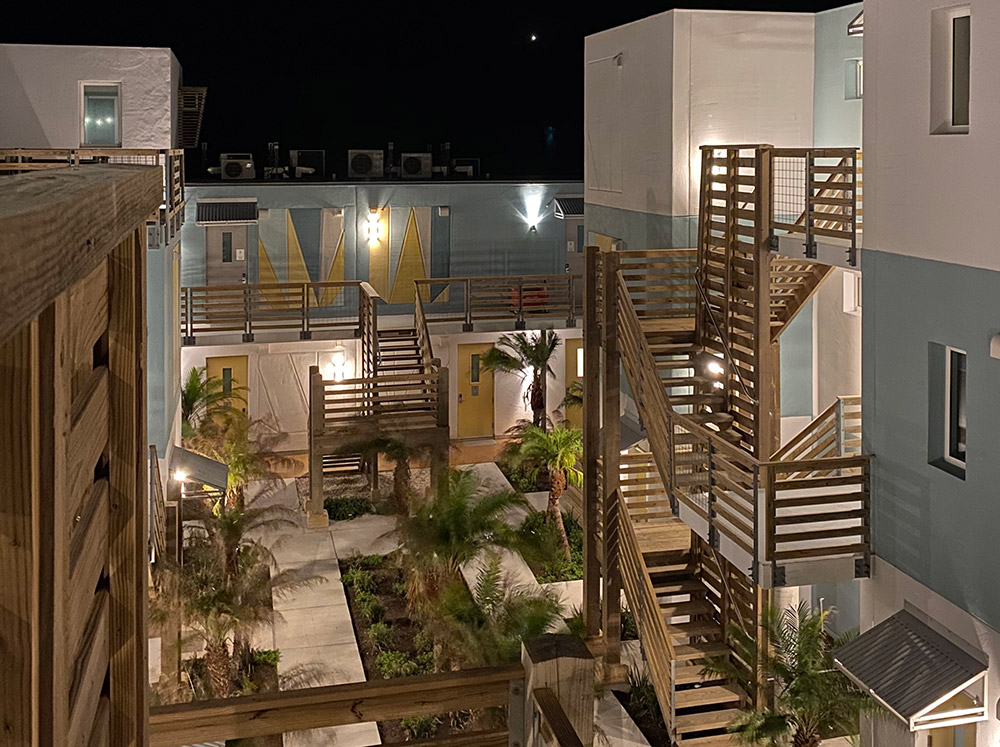 Lively Beach Surfrider courtyard at night