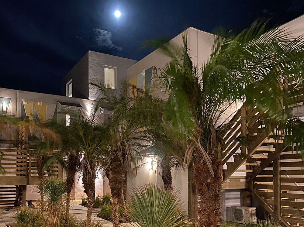 Lively Beach Surfrider courtyard with the moon